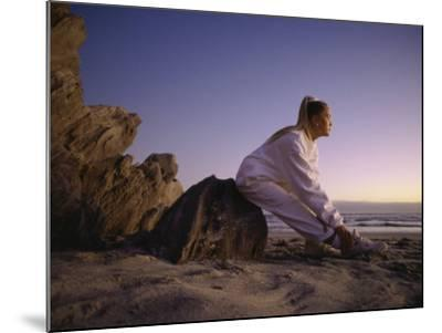 Young Woman Exercising on the Beach--Mounted Photographic Print