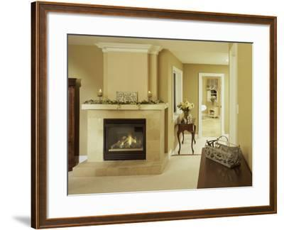 A Fire in the Fireplace and Candles on the Mantle--Framed Photographic Print