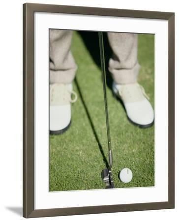 Low Section View of a Man Putting a Golf Ball--Framed Photographic Print