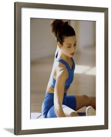 Brunette Stretching--Framed Photographic Print