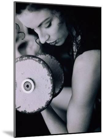 Young Woman Exercising with Dumbbells--Mounted Photographic Print