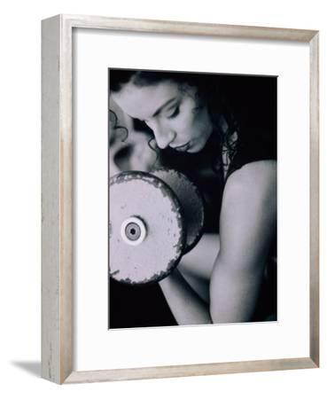 Young Woman Exercising with Dumbbells--Framed Photographic Print