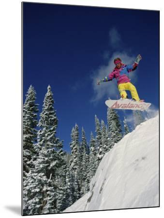 Airborne Snowboarder--Mounted Photographic Print