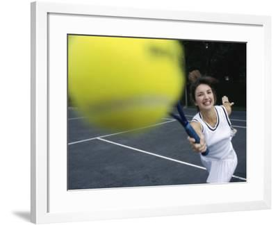 Close-up of a Young Woman Playing Tennis--Framed Photographic Print