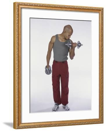 Young Man Exercising with Dumbbells--Framed Photographic Print