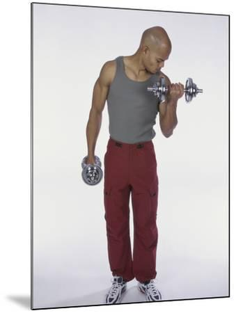 Young Man Exercising with Dumbbells--Mounted Photographic Print