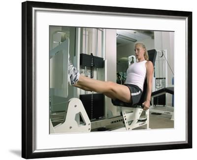 Woman Working Out on a Weight Machine--Framed Photographic Print