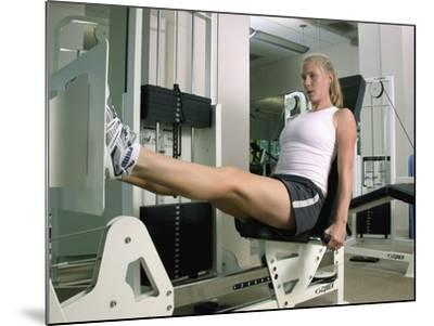 Woman Working Out on a Weight Machine--Mounted Photographic Print