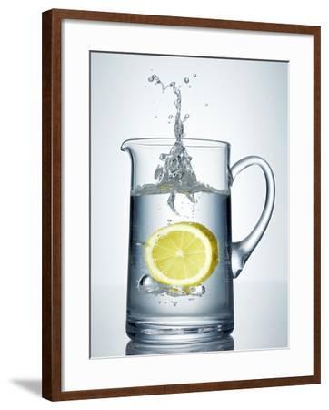Lemon Falling into Jug of Water-Petr Gross-Framed Photographic Print