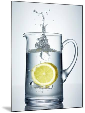Lemon Falling into Jug of Water-Petr Gross-Mounted Photographic Print