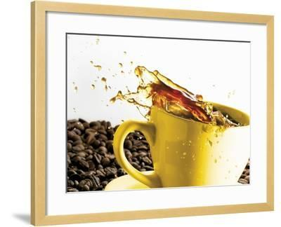 Coffee Spilling Out of a Cup-Dieter Heinemann-Framed Photographic Print