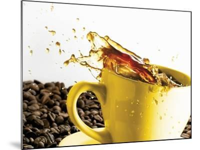 Coffee Spilling Out of a Cup-Dieter Heinemann-Mounted Photographic Print