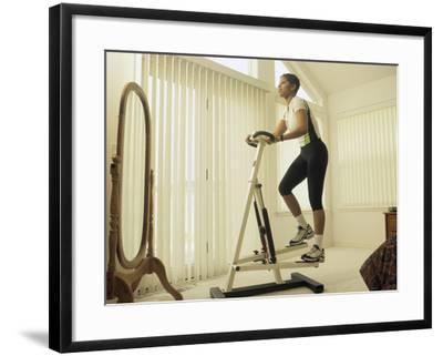 Low Angle View of a Woman Exercising--Framed Photographic Print