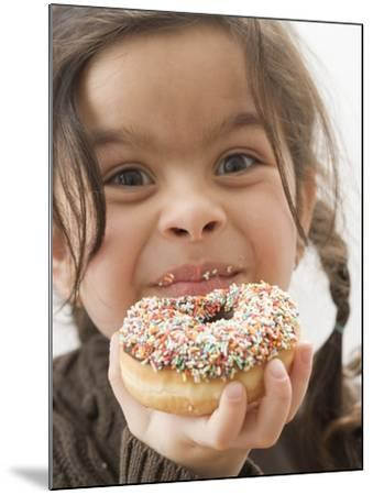 Girl Holding a Doughnut with Sprinkles, Partly Eaten--Mounted Photographic Print