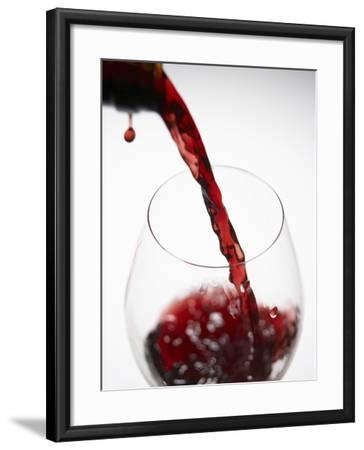 Pouring Red Wine-Joerg Lehmann-Framed Photographic Print