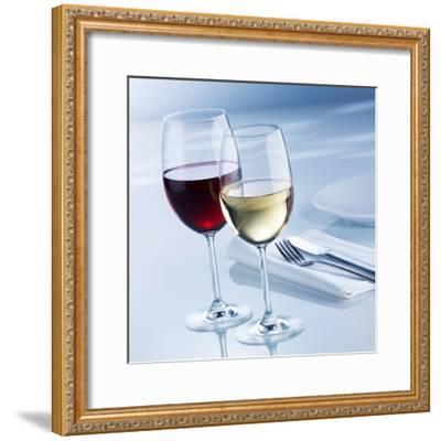 Glass of White Wine and Glass of Red Wine Beside Place-Setting-Alexander Feig-Framed Photographic Print