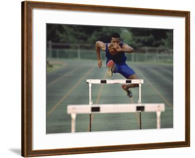 Leaping Over Hurdles--Framed Photographic Print