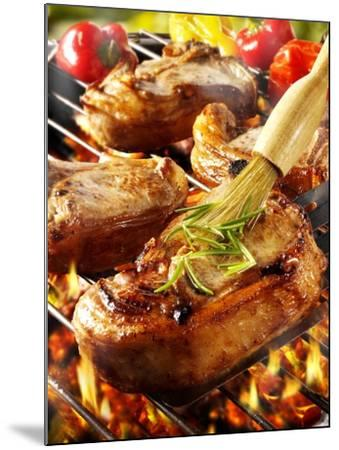 Brushing Pork Chop on Barbecue Rack with Oil-Paul Williams-Mounted Photographic Print