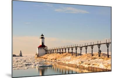 Lighthouse on Sunny Winter Day with Man Running- ErynnZ-Mounted Photographic Print