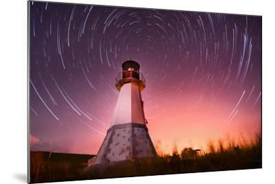 Lighthouse with Night Sky at Background Stars Trails- Q-lieb-in-Mounted Photographic Print