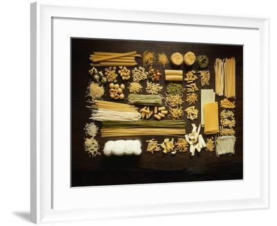 Many Different Types of Pasta on Dark Wooden Background-Walter Cimbal-Framed Photographic Print