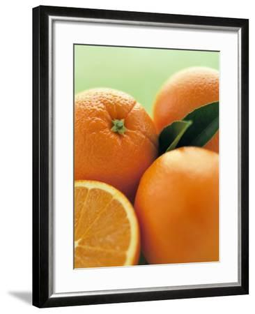 Oranges with Leaves Close Up-Leigh Beisch-Framed Photographic Print