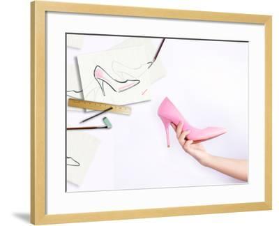 Female Hand Holding Shoe-Anna Ismagilova-Framed Photographic Print