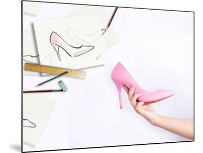 Female Hand Holding Shoe-Anna Ismagilova-Mounted Photographic Print