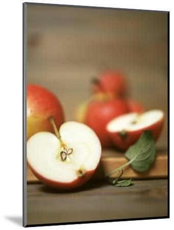 Several Apples, One Halved-Uwe Bender-Mounted Photographic Print