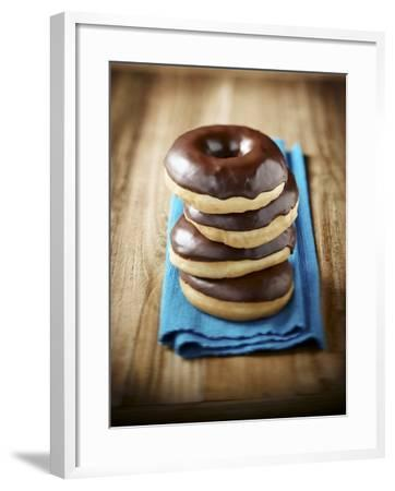 Four Doughnuts with Chocolate Glaze, Stacked-Michael L?ffler-Framed Photographic Print