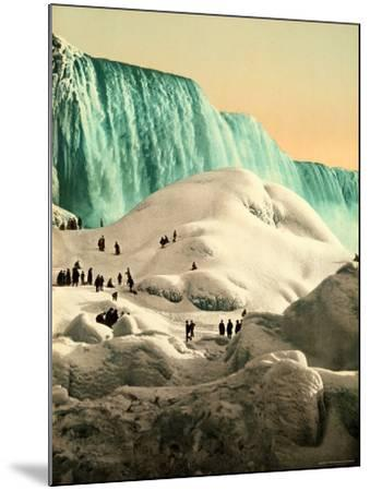 Some People Walk on the Snow, at Their Back, the Niagara's Falls--Mounted Photographic Print