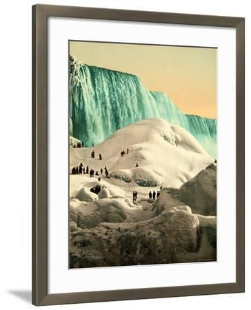 Some People Walk on the Snow, at Their Back, the Niagara's Falls--Framed Photographic Print