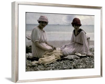 Two Women Sitting on the Beach-Henrie Chouanard-Framed Photographic Print