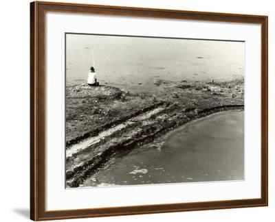 Fisherman Sitting on the Bank of a River Holding a Fishing Pole in His Hand-Vincenzo Balocchi-Framed Photographic Print