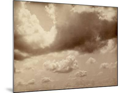 Stretch of Sky with Large Clouds. the Silhouette of the Hills Can be Made out Below--Mounted Photographic Print