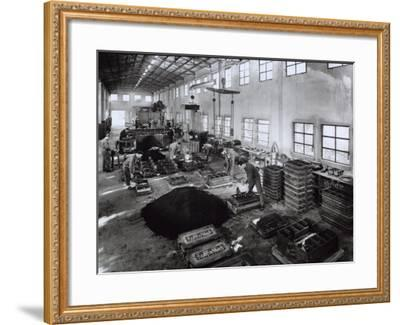 Inside of a Ferrari Factory with Some Workers-A^ Villani-Framed Photographic Print