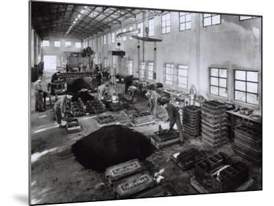 Inside of a Ferrari Factory with Some Workers-A^ Villani-Mounted Photographic Print