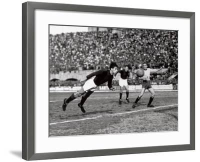 Soccer Player Shown While Heading the Ball-A^ Villani-Framed Photographic Print