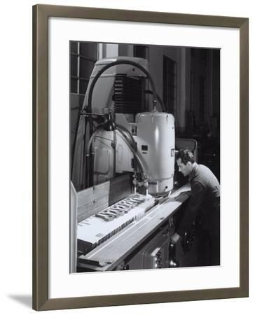 Worker Operating a Machine in the Ferrari Factory-A^ Villani-Framed Photographic Print