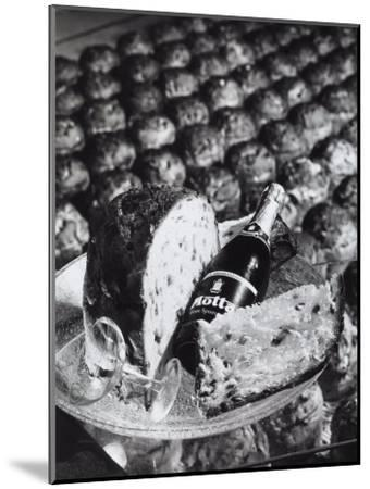 Pannetone, a Bottle of Champagne and a Glass Sitting on a Platter-A^ Villani-Mounted Photographic Print