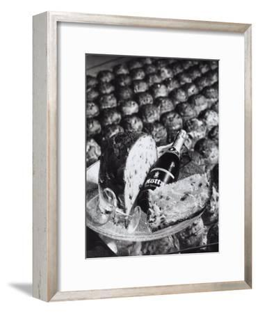 Pannetone, a Bottle of Champagne and a Glass Sitting on a Platter-A^ Villani-Framed Photographic Print