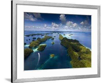 An Aerial View of a Boat as it Speeds Through the Rock Islands, Republic of Palau.-Ian Shive-Framed Photographic Print