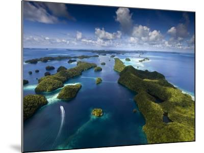 An Aerial View of a Boat as it Speeds Through the Rock Islands, Republic of Palau.-Ian Shive-Mounted Photographic Print