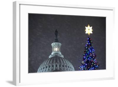 Snow Falls on the U.S. Capitol Christmas Tree During a Lighting Ceremony in Washington, DC, USA-Matthew Cavanaugh-Framed Photographic Print