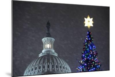 Snow Falls on the U.S. Capitol Christmas Tree During a Lighting Ceremony in Washington, DC, USA-Matthew Cavanaugh-Mounted Photographic Print