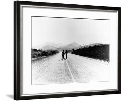 """Charlie Chaplin, Paulette Goddard. """"The Masses"""" 1936, """"Modern Times"""" Directed by Charles Chaplin--Framed Photographic Print"""