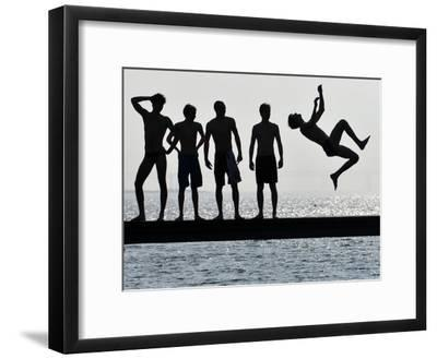 Boys Jumps into the Water on the First Sunny Spring Day in Malmo-Johan Nilsson-Framed Photographic Print