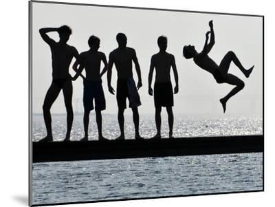 Boys Jumps into the Water on the First Sunny Spring Day in Malmo-Johan Nilsson-Mounted Photographic Print