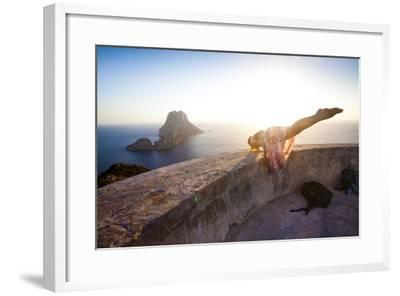 A Young Woman Does an Acrobatic Yoga Pose at the Torre Des Savinar Lookout Tower in Sw Ibiza-Day's Edge Productions-Framed Photographic Print