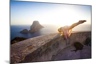 A Young Woman Does an Acrobatic Yoga Pose at the Torre Des Savinar Lookout Tower in Sw Ibiza-Day's Edge Productions-Mounted Photographic Print